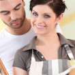 Couple looking at a cookbook — Stock Photo #8167738