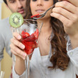 Couple eating strawberries from a glass — Stock Photo