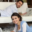 Couple relaxing in their living room — Stock Photo