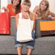 Stock Photo: Three woman, holding shopping bags