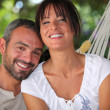 Couple in hammock — Stock Photo
