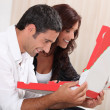 Stock Photo: Couple with take-out pizza boxes