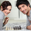 Stock Photo: A couple playing chess