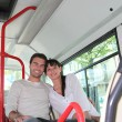 Young couple sitting in the bus - Stock Photo