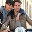 图库照片: Biker with girlfriend