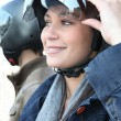 Womturning up her motorcycle helmet visor — Stock Photo #8168527