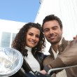 Couple sat on scooter — Stock Photo