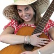 Stock Photo: Young womwith acoustic guitar