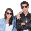 Young couple posing in sunglasses and leather jacket — Stock Photo