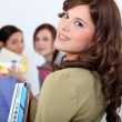 Young woman meeting up with her friends at school — Stock Photo #8168837