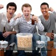 Three teenagers having a party at home — Stockfoto
