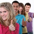 Young group of giving thumb's up — Stock Photo #8168895