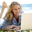 Woman on laptop outside — Stock Photo