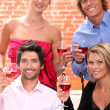 Friends drinking wine — Stock Photo