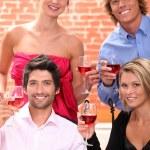 Friends drinking wine — Stock Photo