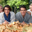Adults lying in leaves — Stock Photo