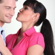 Woman giving a kiss to a guy — Stock Photo #8169275