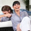 Young couple laughing at home - Stock Photo