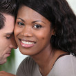 Affectionate mixed-race couple — Stock Photo