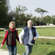 Middle-aged couple taking a stroll — Stock Photo