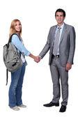 Student and teacher handshake — Stock Photo