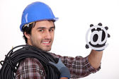 Electrician with an @ sign — Stock Photo