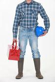 Builder holding tool box — Stock Photo
