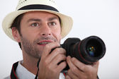 Tourist taking a photo with a DLSR camera — Stock Photo
