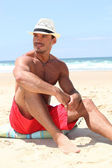 Handsome man on the beach — Foto Stock