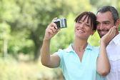 Couple taking a self portrait — Stock Photo