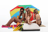 Three girls at the beach — Stock Photo