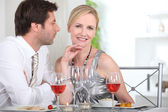Couple in restaurant having romantic meal — Stock Photo