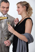 Glamourous couple drinking champagne — Stock Photo