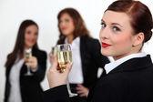Three businesswomen toasting success — Stock Photo