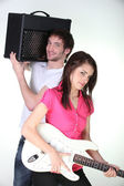 Boy and girl in a music band — Stock Photo