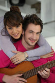 Boyfriend playing the guitar — Stock Photo