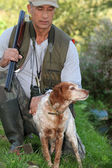 A hunter and his dog — Stock Photo