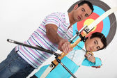 Brothers practising archery — Stock Photo