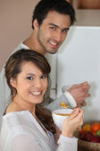 Couple having breakfast standing up — Stock Photo