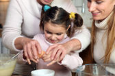 Little girl baking with her family — Stock Photo