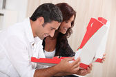 Couple with take-out pizza boxes — Stock Photo