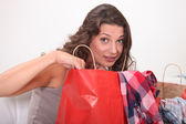 Young woman at home examining shopping bags — Stock Photo