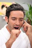 Man yawning on phone — Stock Photo