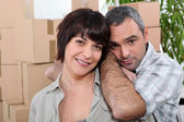 Man and woman moving into a new apartment — Stock Photo