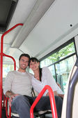 Young couple sitting in the bus — Stock Photo