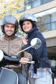 Couple riding on scooter — Stock Photo