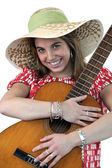 Young woman with an acoustic guitar — Stock Photo