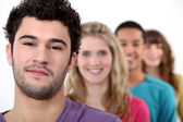 Young standing in a row — Stock Photo
