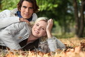 Couple lying on the ground — Stock Photo
