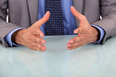 Closeup on businessman's hands during speech — Stock Photo